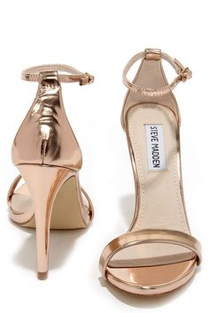 Either with your beau or on your own, wherever you go the Steve Madden Stecy Rose Gold Ankle Strap Heels will step up your style! These chic high heel sandals are made from metallic rose gold faux leather, with an on-trend single toe band and an adjustable ankle strap (with gold buckle) anchored by a slender heel cup.