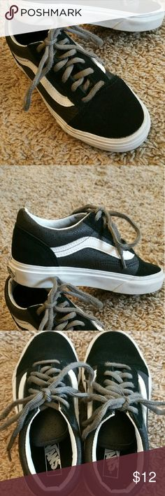 "Kids Vans shoes Like new  kids black and white Vans ""off the wall"" shoes in excellent condition. Only worn once or twice and no noticeable wear at all. My son couldn't tie laces so these were never worn. Vans Shoes Sneakers"