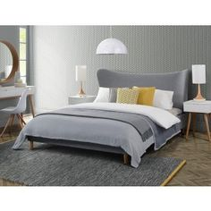 Retro Hackney Grey Upholstered Bed | i love retro | A distinctively striking bed with a sculptural wraparound headboard. Upholstered in a stylish grey fabric for warmth and comfort. Solid oak legs add to the Mid-century vibe and match other pieces within our Mid-Century Hackney range. Definitely a statement piece for your bedroom. Pictured teamed with a pair of our Hackney White Mid Century Side Tables used as bedside tables. Includes a sprung slatted base and practical 100% polyester fabric