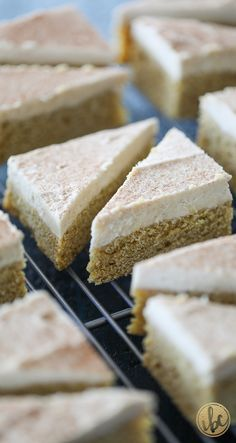 It's #FallCookieWeek and These Pumpkin Cookie Bars with Maple Buttercream Frosting are the perfect fall dessert recipe full of seasonal pumpkin spice and maple flavor. #fallcookieweek #pumpkin #cookie #dessert #fallbaking #recipe