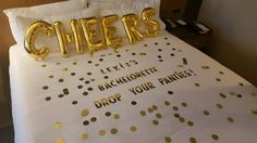 """Lingerie Shower in a hotel room, make the bed part of the decor  gold letter stickers, """"*bride's name* Bachelorette, Drop Your Panties!"""""""