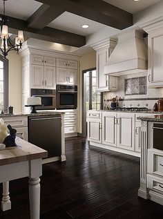 This kitchen cabinetry was created with the Concord door style in Maple finished in White with Bronze glaze.