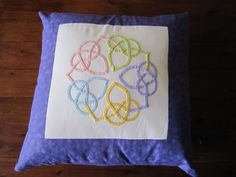 Celtic knot pillow by nilmerg, made from a block stitched by kwiltykate, both members of Craftster.org