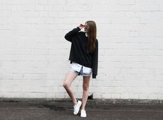 I am wearing a #sunglasses from #rayban, #sweater from #allsaints, blouse from #cos, shorts from #closed and sneakers from #sandro.