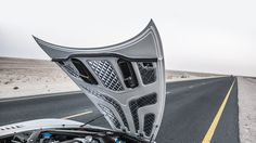 The underside of the hood of an Aston Martin One-77. Too bad you'll never be able to drive one. Only 77 are made.