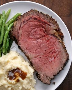 """1 c softened butter, 7 cloves minced garlic, 2 TB fresh: rosemary, thyme & salt, 1 TB pepper, 5-7 lbs trimmed boneless ribeye roast, 2 TB flour, 2c beef stock~ Mix butter, garlic, herbs, S&P. Rub all over roast. Place on rack in tray. Bake 500°F 5 mins/lb. Turn off heat & let roast sit in oven for 2 hrs. (do not open door).  Remove roast. Heat drippings in saucepan med heat.  Whisk in flour, then stock→boil. Remove & strain.   Carve roast into ¾"""" slices."""