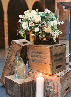 Rustic/vintage wooden boxes, candles, floral arrangement