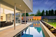 White-House-Accommodating-an-L-Shaped-Alfresco-Pool-in-Caulfield-North-by-Serenity-Pools_2
