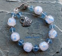 Lampwork and crystal bracelet with handbag charm. www.facebook.com/bubbasbeads