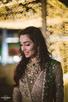 Bridal Jewelry - Bride in a Gold Outfit with Polki and Emerald Necklace | WedMeGood | Photo by: Aviraj Saluja Wedding Photography #wedmegood #indianbride #jewelry #indianweddingjewelry #polki #emerald #gold #green