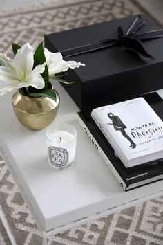 Homevialaura | Net-A-Porter black box | How to be Parisian book | diptyque candle | Madam Stoltz golden vase from Boutique Rosa
