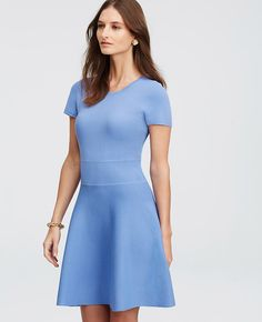"Ribbed at the waist for an incredibly flattering fit, this subtly flared style turns heads in the season's most sought after hues. Jewel neck. Short sleeves. Ribbed waistband. 34 1/2"" from shoulder to hem."