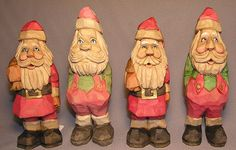 Flat Plane Santas carved by Russell Scott