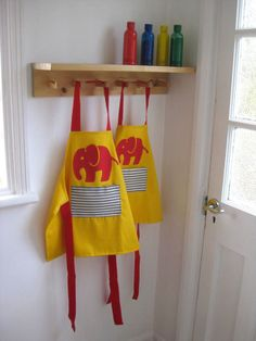 SOLD OUT. Childrens Yellow Efalant Apron. size 1-2, 3-4years £18/£20