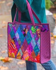The Gem Bag sewing pattern uses Dancing Diamonds Art quilt and turns it into a stunning, sophisticated quilted tote bag.