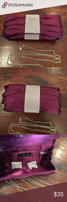 Evening clutch Plum color. Crystals all the way around. Includes chain for shoulder use. Never used. j francis Bags Clutches & Wristlets