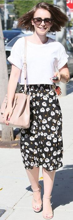 White cropped tee, black floral skirt, and pink tote handbag