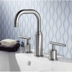 This bathroom faucet features a chrome finish that will easily complement any decor. The contemporary design will appeal to any modern home owner. American Standard Serin Widespread Bathroom Faucet 20