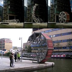 Rather than a conventional opening bridge mechanism, consisting of a single rigid element that lifts to let boats pass, the Rolling Bridge gets out of the way by curling up until its two ends touch. [link]