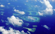 Aerial Journey Around Maldives Photograph by Jenny Rainbow Aerial Photography, Fine Art Photography, Wood Print, Maldives, My Images, Around The Worlds, Journey, Rainbow, Clouds