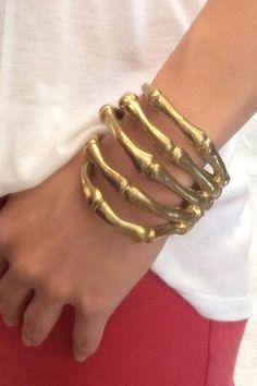 Skeleton fingers bracelet.
