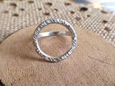 This simple yet chic ring boasts an open circle concept, handmade using sterling silver. I textured the circle which makes each ring slightly