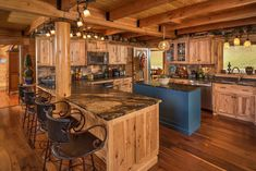 Custom log home with hickory cabinets and leathered granite counter tops