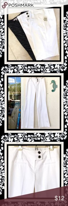 """🌺🌴🌺 TRENDY WHITE PANTS 🌺🌴🌺 🌺🌴🌺 These stylish and now again very trendy pair of pants have a wide waistband with two black and silver buttons.  There are two faux pockets on the front and none in back.  The fabric is:  67% cotton, 30% polyester and 3% spandex with moderate stretch.  The waistband is:  33"""".  The length:  41"""".  Inseam:  32"""" and leg opening:  11 1/2"""".  The black and silver blouse is for sale too.  They would really look good and add more style with the nautical handbag…"""