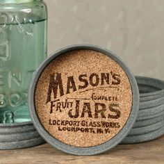 "Mason Jar Lid Coasters Give yourself that Farmhouse look and add these coasters to any room or give them as a hostess gift. Features cork inside to absorb moisture with a vintage Mason jars logo printed in waterproof ink. Set of 4 coasters $18.95  3¾"" dia. and 1″ tall."