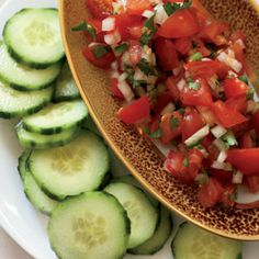 """Super Bowl party food doesn't have to derail your healthy eating efforts. Here are four easy, delicious and crowd-pleasing healthy snacks for the ultimate Super Bowl party.  This tomato salsa with cucumber """"chips"""" looks great! #HealthySnacks via@FoodAndWine"""