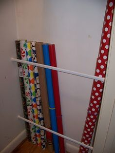 I love using inexpensive tension rods (either shower rods or curtain rods) for everything. Here, they corral wrapping paper on the inside of a closet.