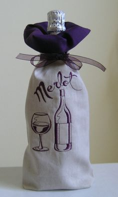 Make your gift of wine or champagne special when you give it in this embroidered bag. The bag is handmade from natural colored linen and lined in