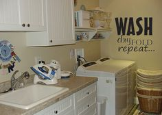 Laundry room quote Wash Dry Fold Repeat vinyl wall decal.