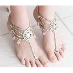 Farrah II Barefoot Sandals Pearl. Beaded Pearl Anklet with Toe Ring. These Barefoot Sandals are Draped with Pearls and Rhinestones.Beautiful Indian Bridal Foot Jewelry with Pearl Accents are Perfect for a Wedding on the Beach. This BareFoot Sandal Design will Compliment the Bride or her Bridesmaids. Add the Finishing Touches with these Elegant Beaded Bare Sandals with Silver Ankle Chains. Adjustable at the Back of the Foot.