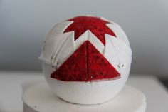 Photo tut on blog. This is pinned to styrofoam and glued. Lovely! Quilted Ornament Tutorial