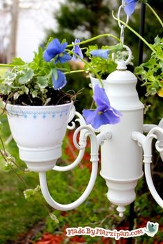 Turn an old chandelier into a combination bird feeder & planter. Learn how to drill holes in tea cups for drainage. How to:chandelierwire cuttersscrewdriverpliersteacupsglass & tile bitelectric drillsandpapere6000 glueflowersbirdseedplant hangeroutdoor spray paintYou'll need an old chandelier. My local thrift store almost always has a few. You can paint it if you don't like the color …