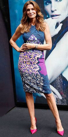 Last Night's Look: Love It or Leave It? Vote Now! | CINDY CRAWFORD | in a colorful, multi-pattern halter dress teamed with red pointy toed pumps at the launch of Omega's Constellation Pluma Collection in Mumbai, India.