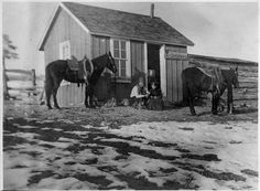 """Man and woman outside """"Happy Days Saloon"""" by Douglas County History Research Center, via Flickr"""