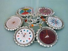 George Nelson clocks wine charms mid-century modern party favors. Set of 6.. $18.00, via Etsy.