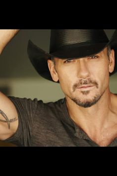 Tim McGraw , I'd just like you to know if you were a tree , I'd climb the absolute shit out of you(:
