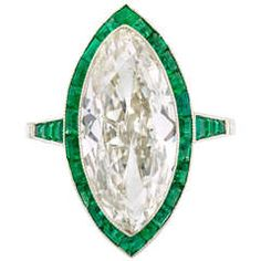 Lots of really lovely and unique estate pieces on this site.  Edwardian Marquise Diamond Ring with Calibre Emerald Border