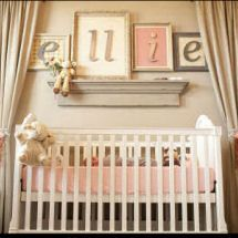 letters in frames and curtains around the crib?