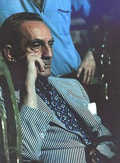 Noted film director Luchino Visconti. Love the tie with the striped jacket.