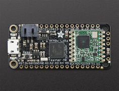 """This is the Adafruit Feather M0 RFM95 LoRa Radio (433 or 900 MHz) - our take on an microcontroller with a """"Long Range (LoRa)"""" packet radio transceiver with built in USB and battery charging. Its an Adafruit Feather M0 with a Long Range radio module cooked in! Great for making wireless networks that are more flexible than Bluetooth LE and without the high power requirements of WiFi."""