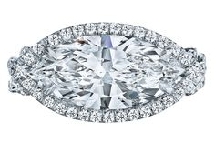 Platinum twist halo ring with a marquise diamond by Leo Ingwer