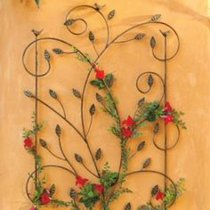 Bird Garden Trellis: probably the prettiest trellis out there while waiting for the vines to grow!