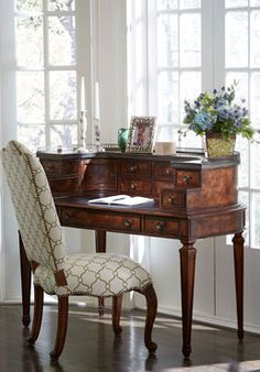 Pretty is as pretty does! Antique styling and classic lines make this Pauline Writing Desk a heirloom for the home.