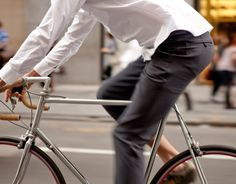 Bike. Slacks. Untucked shirt. Casual class.