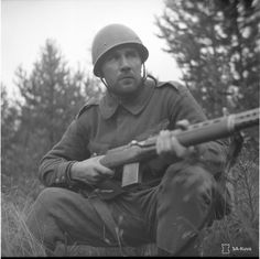 A Finnish soldier armed with a Soviet semi-automatic SVT-40 rifle. 2 September 1941.