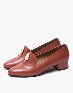 Handmade, vintage-inspired pumps from Anne Thomas in Amber. Slip-on design. Pointed toe. Low heel. Gold-tone accent at vamp.  • Leather upper • Leather sole • Made in Portugal • Women's sizes listed